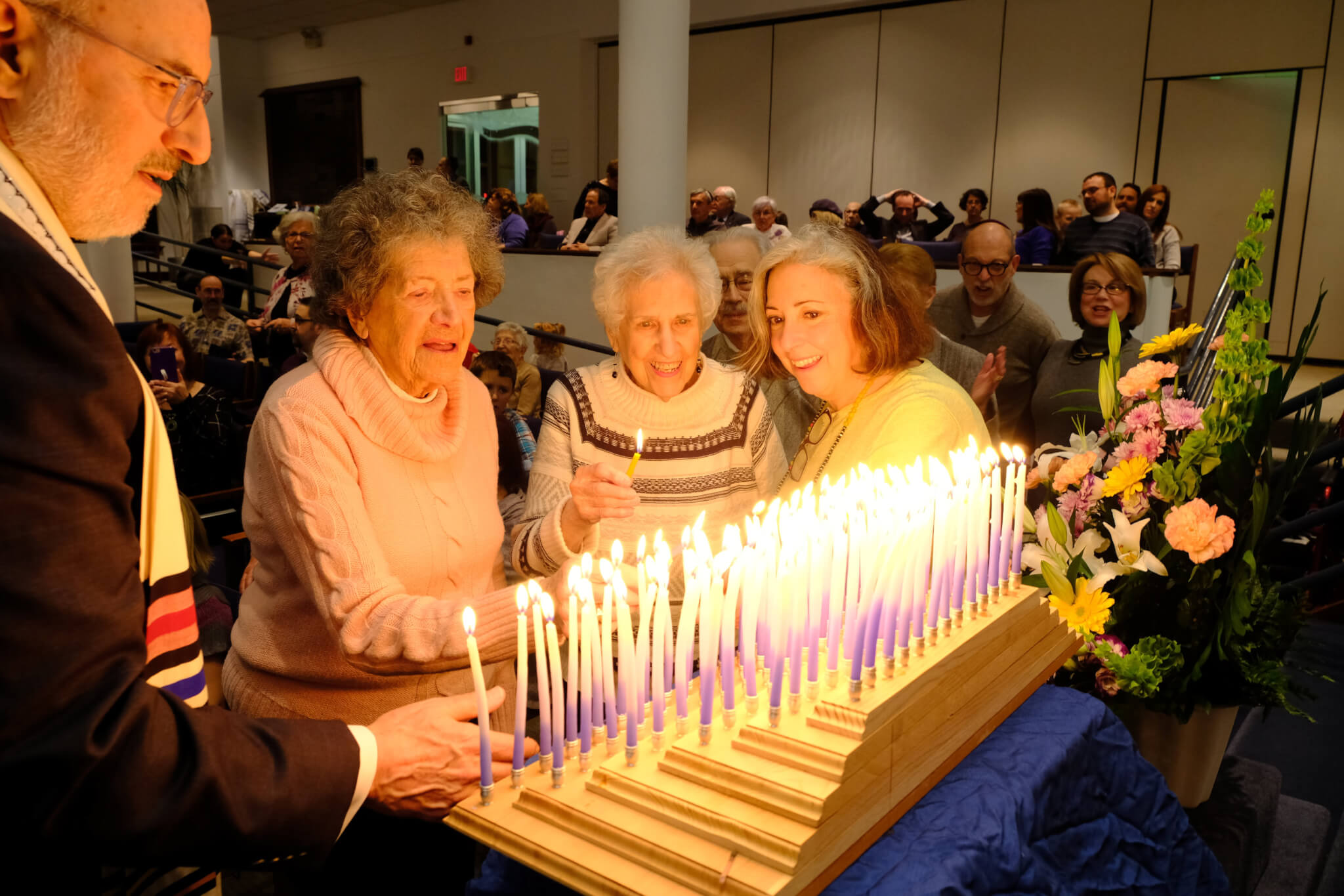 Lighting our 100 candle Menorah - Centennial Hanukah Shabbat